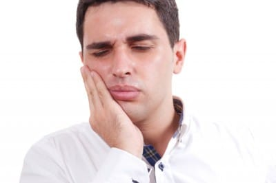 A man suffereing from Jaw Pain