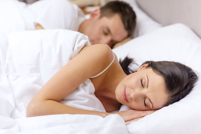 Young couple rests peacefully in bed together