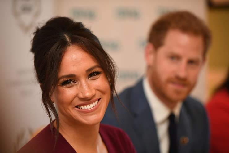 Britain's Meghan, the Duchess of Sussex, and Prince Harry, Duke of Sussex, attend a roundtable discussion on gender equality with The Queen's Commonwealth Trust (QCT) and One Young World at Windsor Castle. Her smile makes headlines everywhere she goes!