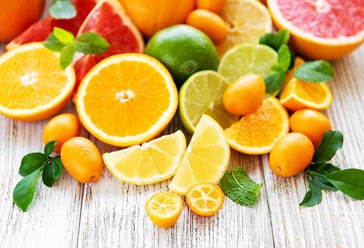 A bunch of fresh citrus foods. Our modern diet has many dangers for your teeth, among them many acidic foods that although help with things like vitamin C, it can destroy your teeth.