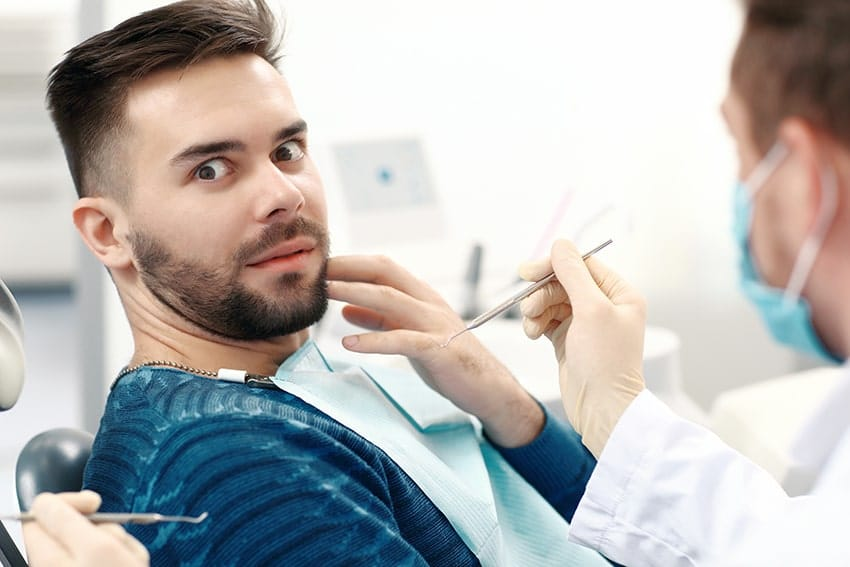 man with anxiety prepares for a dental procedure
