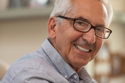 senior man showing off his confident smile with dentures
