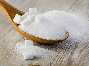 Sugar on a wooden spoon