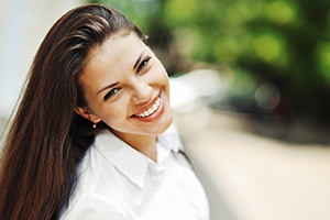Maintain your oral health like this very happy woman by recieving gum treatment at My Hills Dentist in Sydney Australia