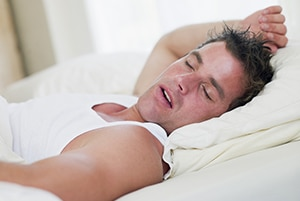 man suffers from sleep apnea
