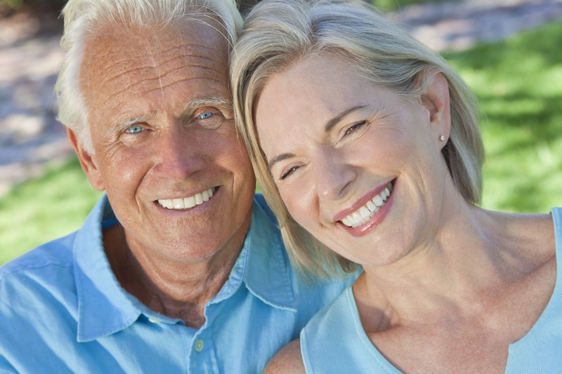Close up of a happy, older couple at the park.